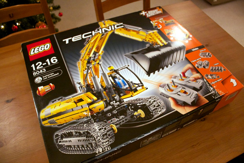 Lego 8043 excavator box placed on desk