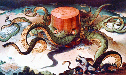 """A cartoon shows a massive octopus labeled """"Standard Oil."""" The octopus's tentacles wrap around a series of tiny buildings and structures, indicating that it controls the steel, copper, and shipping industries; the U.S. Capitol; and a state house. A final tentacle seeks the White House, but has not yet reached it."""