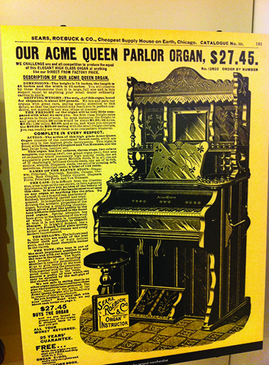 """A page from the Sears, Roebuck & Co. catalog advertises, """"Our Acme Queen Parlor Organ, $27.45,"""" followed by a drawing and description of the product. The header of the page reads """"Sears, Roebuck & Co., Cheapest Supply House on Earth, Chicago."""""""
