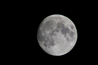 A photograph shows the moon.