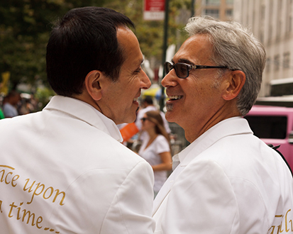 A photo of two recently married men who are smiling.
