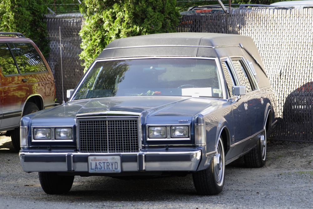 """A hearse with the license plate """"LASTRYD"""" is shown here."""