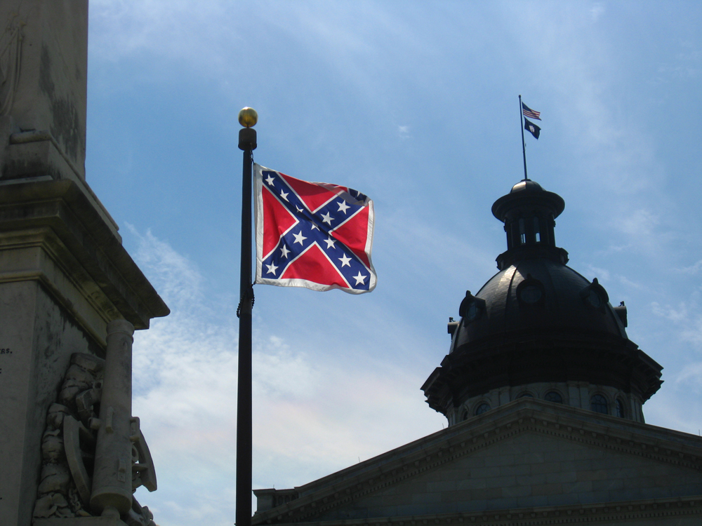 A photo of the Confederate flag hanging on a flagpole