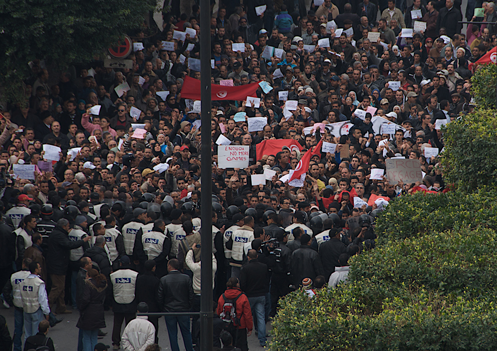 A large group of people marching in protest.