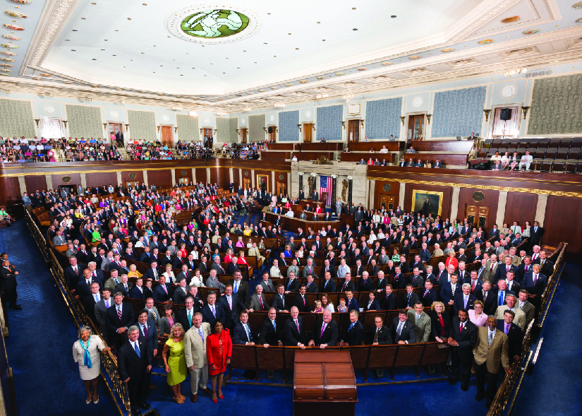An aerial image of a large group of people standing in a room.