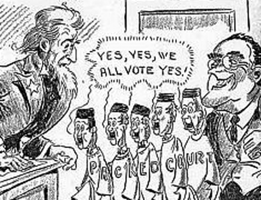 """An illustration of seven people. On the left is an Uncle Sam figure. On the right is a person in a suit with a wide grin and glasses. In between the two people are five people in robes. Letters across all of the robes read """"Packed Court"""". A speech bubble above the five people in robes reads """"Yes, Yes, we all vote yes!""""."""