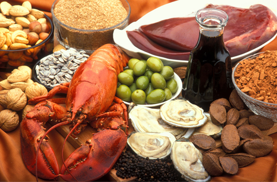 Photo shows a variety of foods, including lobster, clams, nuts and liver.