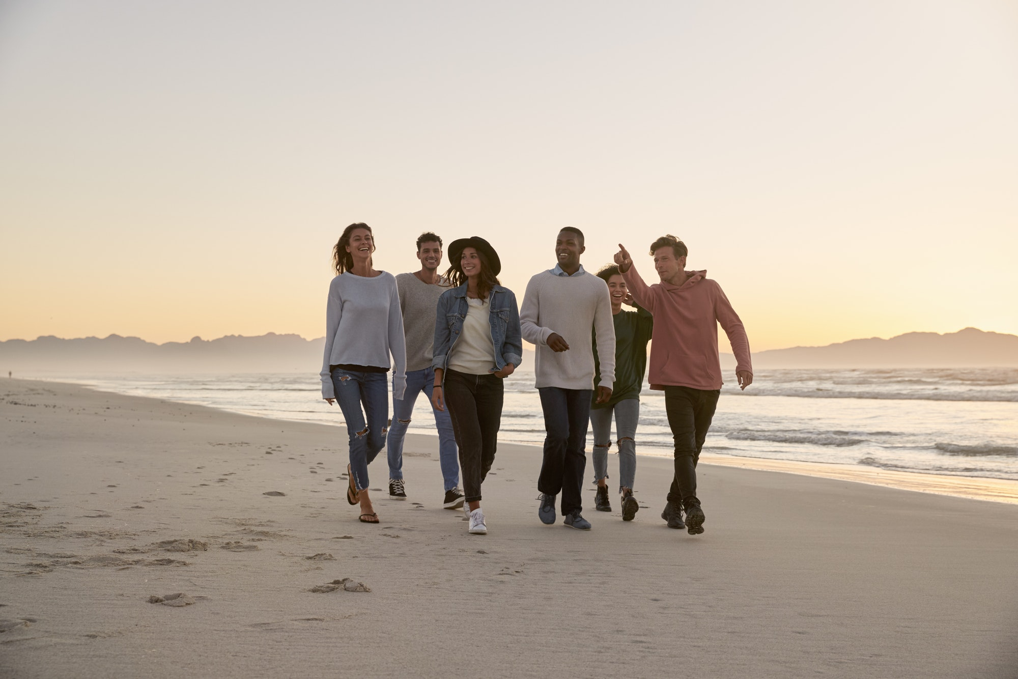 Group Of Friends On Walking Along Winter Beach Together