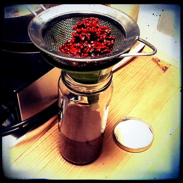 Straining the annatto oil for vegan chorizo