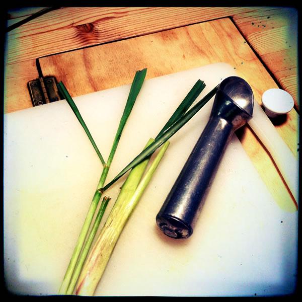 Pounding lemongrass to make extract