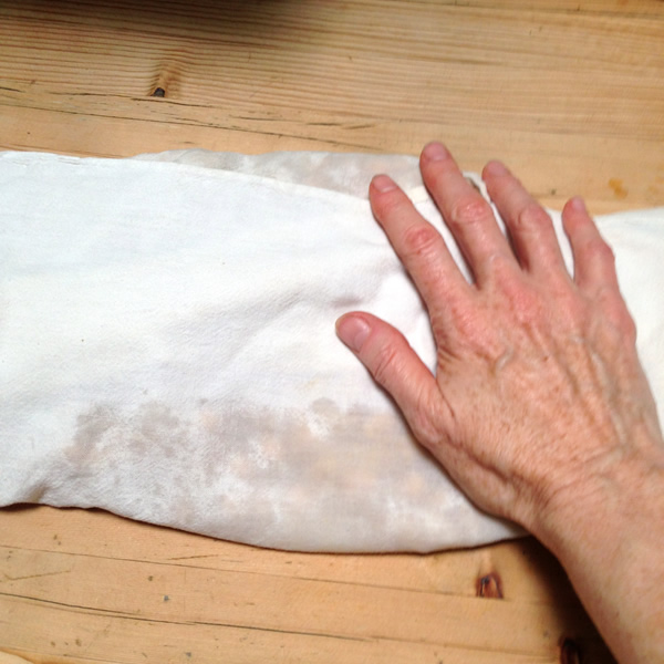 Rolling chickpeas in a towel to remove skins | Recipe Renovator