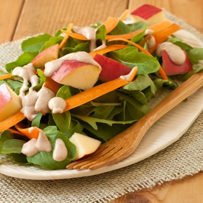 Arugula-apple salad with carrot ribbons and walnut-miso dressing