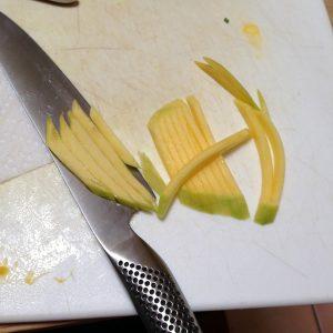 Thinly sliced mango for Mango Salad