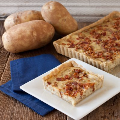 Idaho® potato tart with crispy bacon and caramelized shallots