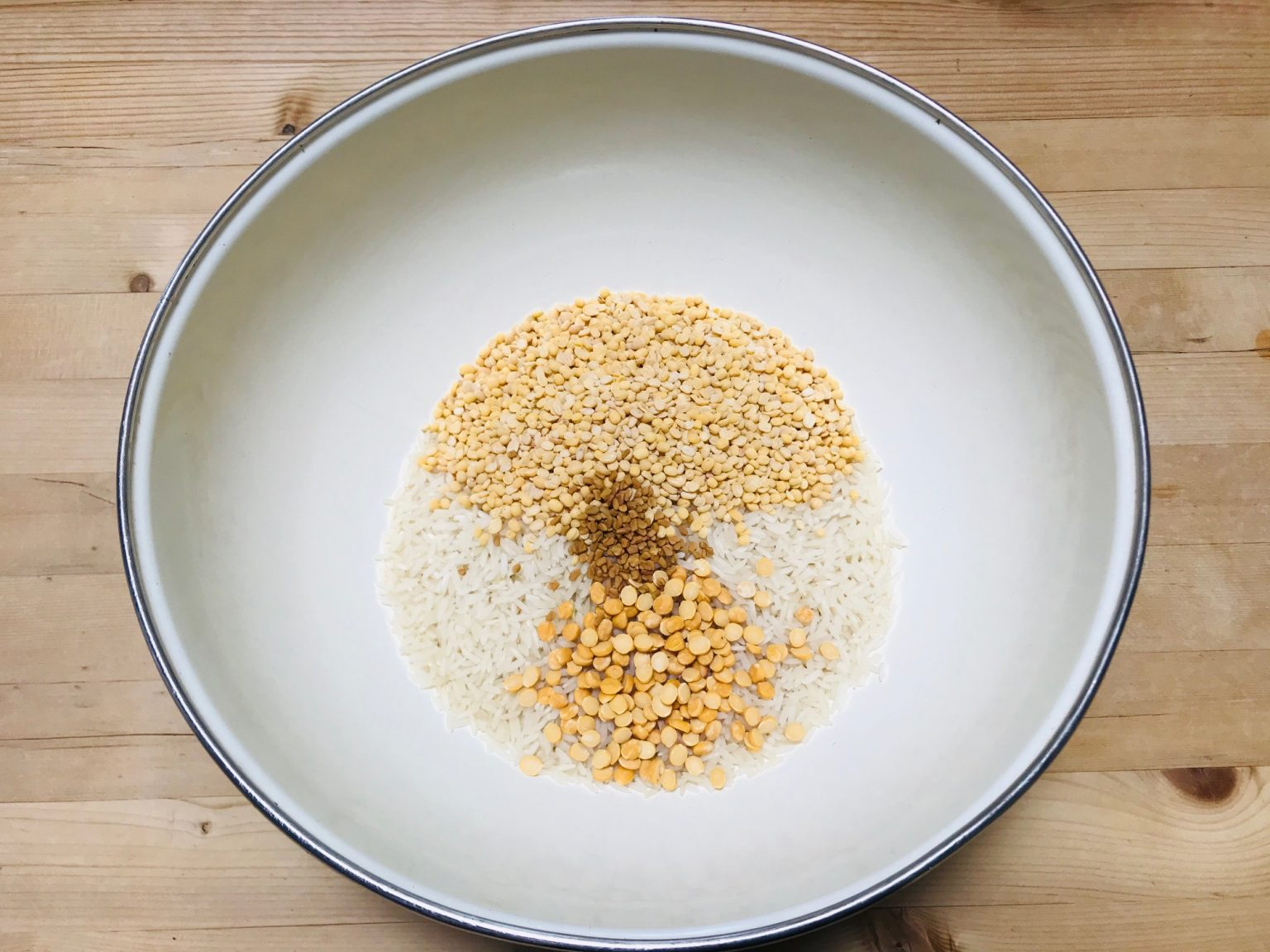 Rice and lentils in bowl to make dosa batter