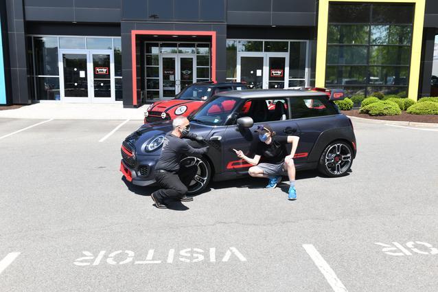 """MINI USA PRESENTS NEW 2021 MINI JOHN COOPER WORKS GP N.0001 TO BRAND'S """"NUMBER ONE FAN""""."""