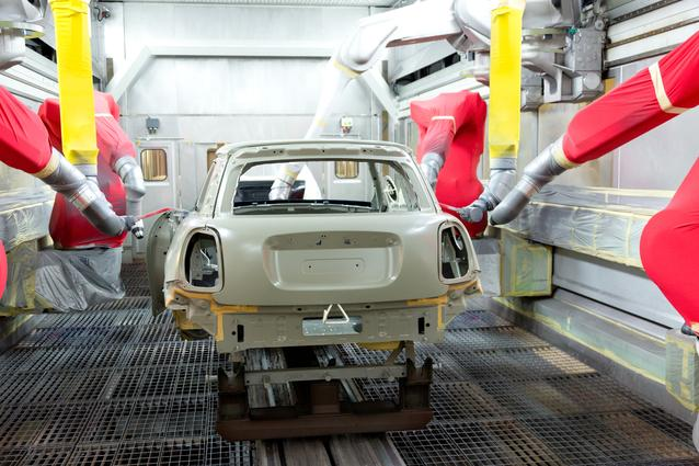 Robots start to open the car doors before the colour coat is applied.