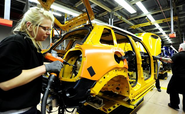 Associates working on the MINI 4-door at the first production line in Plant Oxford's assembly hall.