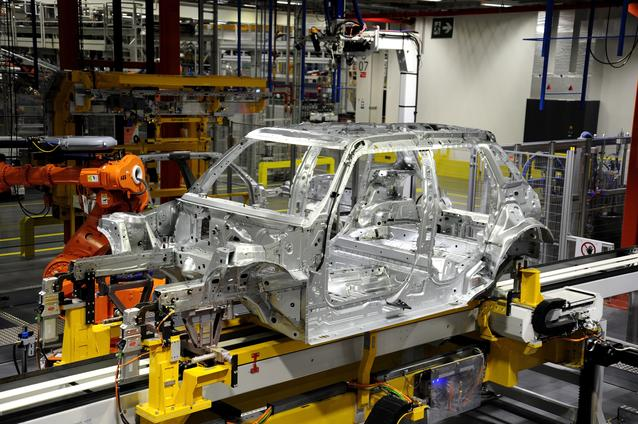 Robots working on the side frame of the new MINI 4-door in Plant Oxford's bodyshop.