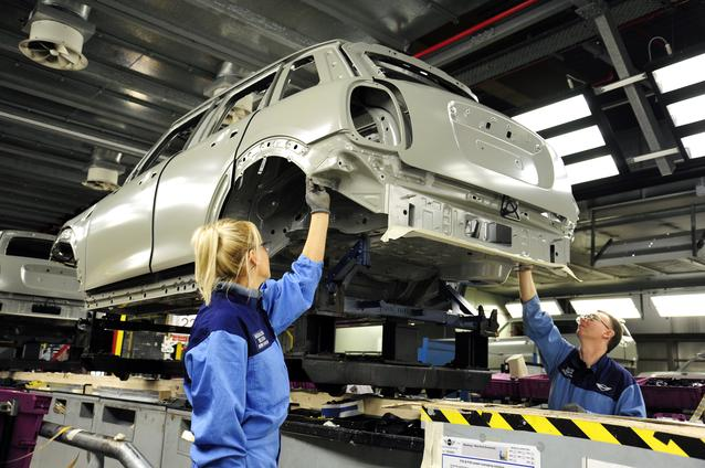 Associates checking the bodyshell of the 4-door MINI on the seam seal line in Plant Oxford's paintshop.