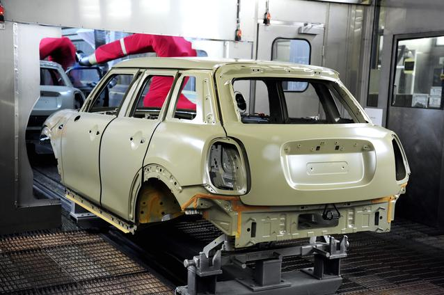 The new 4-door is about to enter the robot spray booth in Plant Oxford's paintshop.