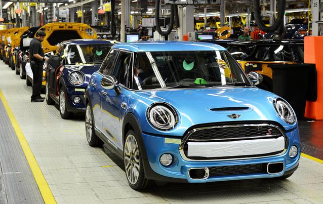 An Electric Blue MINI 4-door comes off the assembly line.