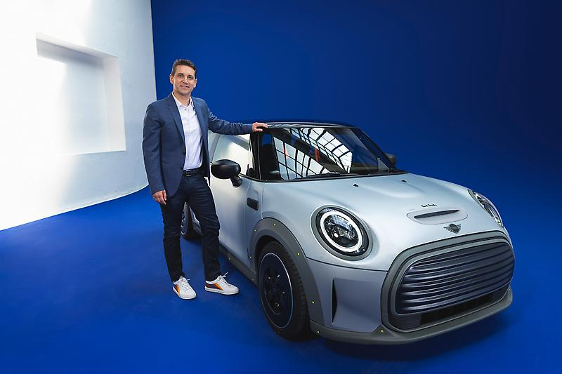 MINI STRIP and Bernd Körber, Head of MINI (08/2021)<br /> <br /> The MINI Strip is a concept car only, meaning it is not in production and not for sale. Therefore, it cannot be driven on the public road and is not compliant to road regulations.
