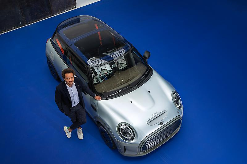 MINI STRIP and Oliver Heilmer, Head of MINI Design (08/2021)<br /> <br /> The MINI Strip is a concept car only, meaning it is not in production and not for sale. Therefore, it cannot be driven on the public road and is not compliant to road regulations.