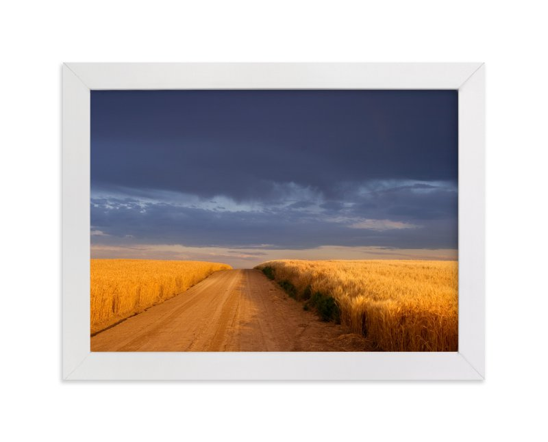 """Dirt Road Through a Wheat Field Under a Stormy Sky"" - Limited Edition Art Print by Kathy Van Torne in beautiful frame options and a variety of sizes."