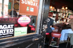 Green insignia posted on the bar door alerts customers to Elixir's eco-practices