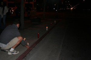 Residents lit candles along Harrison Street in protest of the recent plague of violence.