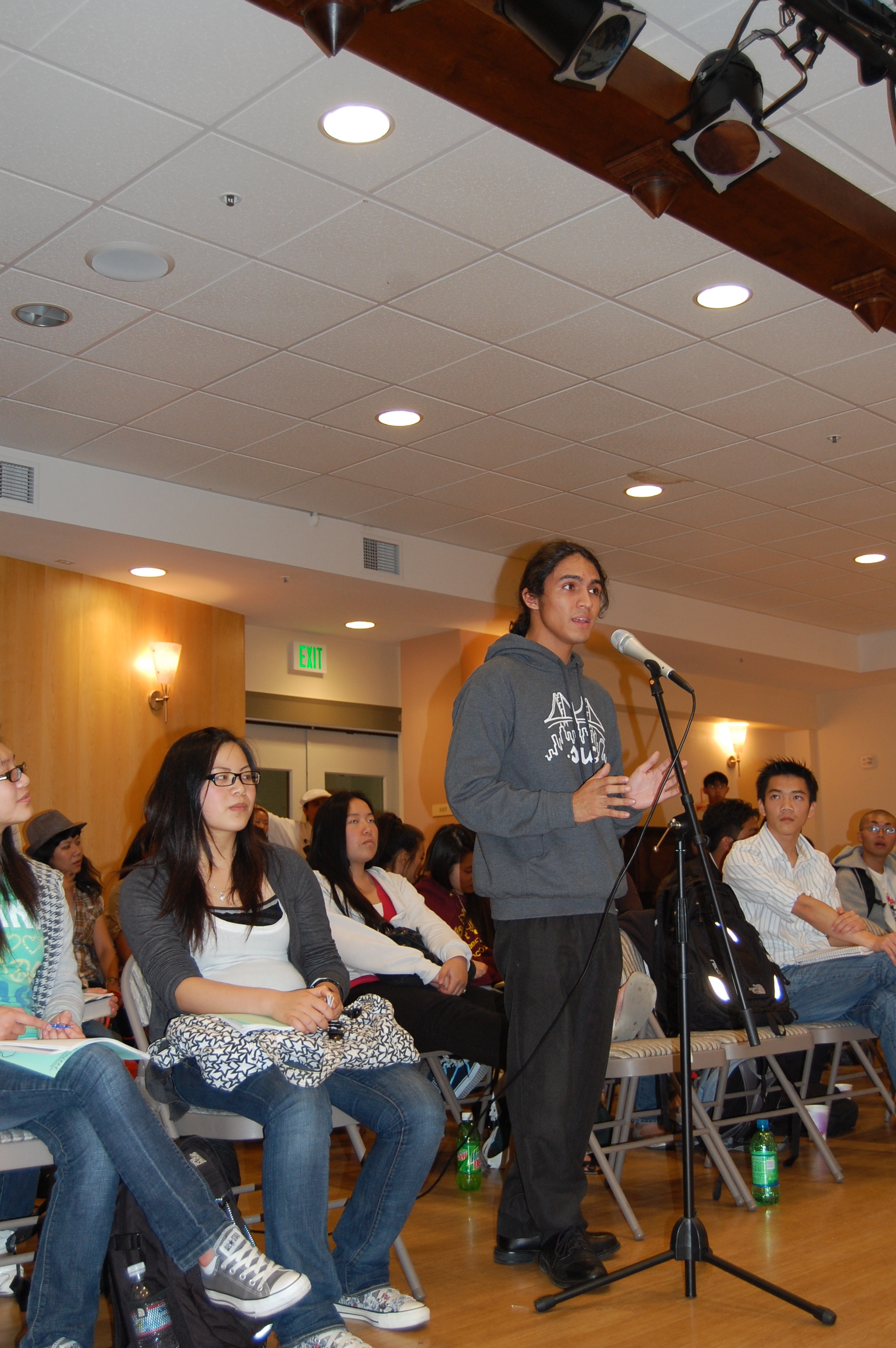 Ben Martinez, 17, directing a question to Board of Education candidates.
