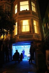 """Performers under the blue spotlight on the stage of """"Garage Azul"""""""