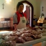 A volunteer mans the bean stand at Julian's Pantry