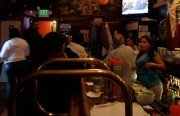 """Carlo's bar on 24th Street celebrated Barack Obama's victory. Owner Carlo Gutierrez said his 35 patrons were """"very happy."""" """"I just hope everything is calm,"""" he added."""