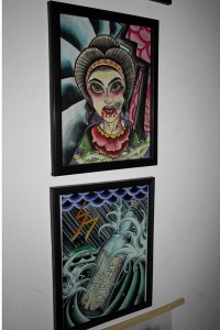 A Caucasian girl with a geisha style and a bottle at sea tattoo sketches made by Wilson Posada hang at Dermafilia tattoo and piercing shop. (Moch N. Kurniawan)
