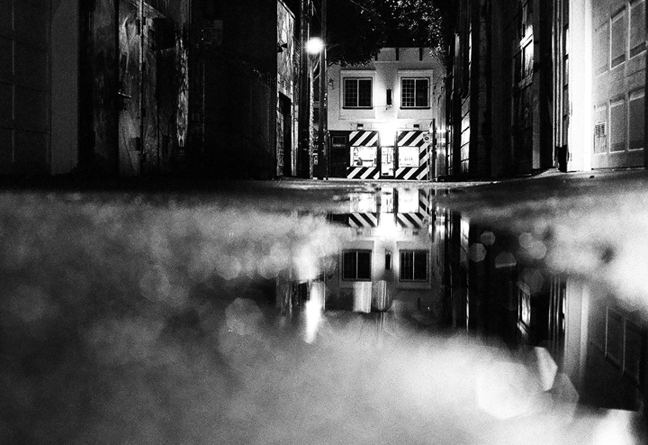 From February 25, 2009. The Lilac Street alley on a rainy night, looking towards El Taco Loco. (Armand Emamdjomeh)
