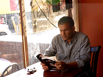 Shabaz Mohammad, co-owner of Pakwan restaurant, takes a break.