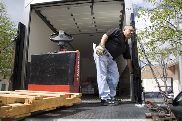 A driver from the San Francisco Food Bank is finishing his job to drop off food at the Mission Neighborhood Centers, which will distribute it to families mostly in Bernal Dwellings public housing. Photo by Moch N. Kurniawan