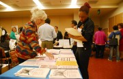 D'Angela Grayson, a 19-year-old making her rounds to employer booths at City College's Job Fair on Wednesday, May 20.