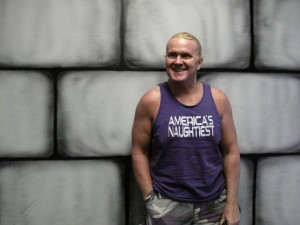 Mike Powers stands in front of one of the walls to be painted over.