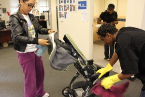 Youth workers clean a donated stroller