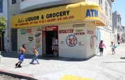 Children play outside Bob's Liquor & Grocery one day after a shooting injures two teens. Photo by Amanda Martinez