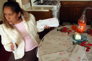 Adelina Vasquez sorts mail received by landlord.