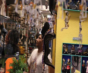 Ricardo Pena co-owner of Mixcoatl shows customer around.