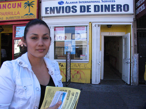 Rosa Herrera in front of Alamar International ServicesProxy-Connection: keep-alive Cache-Control: max-age=0  t 2390 Mission St. (Lily Mihalik)