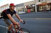 A cyclist rides on Valencia Street.