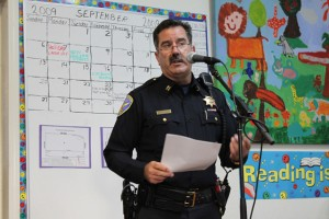 Captain Stephen Tacchini addresses the crowd at Mission Education Projects Inc. on Tuesday.