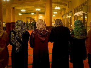 Women pray in the back at Masjid Darussalam, one of two SF mosques without a wall separating men and women.
