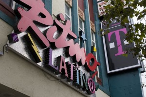 In Oakland, Ca., Ritmo Latino and T-Mobile collide. Both shops are owned by David Massry. Photo by Armand Emamdjomeh